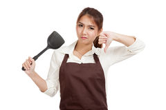 Asian beautiful girl cooking  thumbs down with spade of frying p Stock Photography