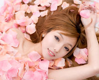Asian beautiful Girl in flower Royalty Free Stock Images