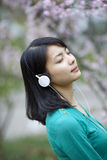 Beautiful girl hearing music with flower Royalty Free Stock Image