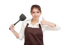 Asian beautiful girl thumbs up with spade of frying pan Royalty Free Stock Photo