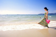 Asian beautiful girl walking on the beach Stock Photo