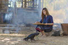 Asian beautiful girl winnowing rice separate between rice and rice husk royalty free stock images