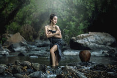 Asian beautiful girls taking bath in a stream Royalty Free Stock Images