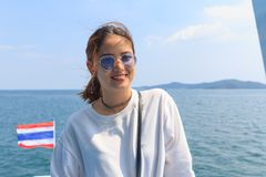 Asian beautiful hipster woman smiling on ship go to the island. Travel trip vacation holiday in Ko Samet, Rayong, Thailand Stock Photos