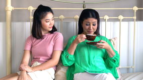 Asian beautiful mother and pretty teenage daughter with tablet stock video