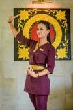 Asian beautiful waitress wearing uniform in the thai restaurant royalty free stock photography