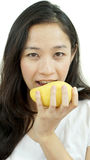 Asian beautiful woman eating mango. Summer delight tropical frui Royalty Free Stock Image