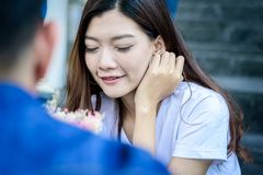 Asian beautiful woman has happy with rose from boyfriend. royalty free stock photos