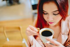 Asian beautiful woman holding a cup of coffee in her hand stock image