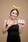 Asian beautiful woman holding March 8th Calendar Women Day Royalty Free Stock Photos