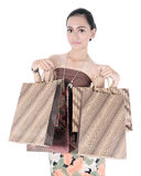 Asian beautiful woman holding shopping bags Royalty Free Stock Photos