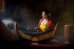 Asian beautiful woman playing xylophone in thailand. royalty free stock photo