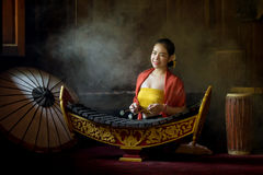 Asian beautiful woman playing xylophone in thailand. royalty free stock image