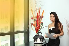 Application document for Job interview, in modern offic room. Asian Beautiful women black hair read report and application document for Job interview, in modern royalty free stock image