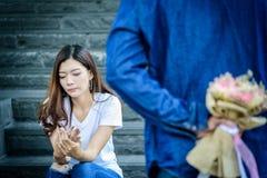 Asian beautiful woman has looking and waiting for word of sorry. Asian beautiful women has looking and waiting for word of sorry from her boyfriend royalty free stock photos