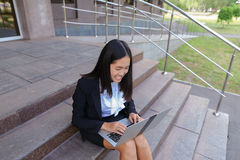 Asian beautiful young female holds in hands laptop and smiling,l Stock Image