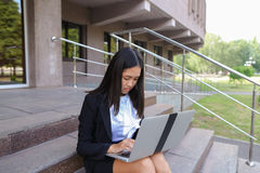 Asian beautiful young female holds in hands laptop and smiling,l Royalty Free Stock Image