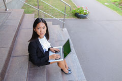 Asian beautiful young female holds in hands laptop and smiling,l Royalty Free Stock Photos