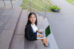 Asian beautiful young female holds in hands laptop and smiling,l Stock Photography