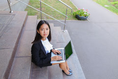 Asian beautiful young female holds in hands laptop and smiling,l Stock Images