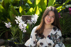 Asian beautiful young woman in the garden royalty free stock photography
