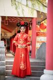 Asian beautiful young woman wearing a traditional Chinese bride dress, royalty free stock image