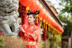 Asian beautiful young woman wearing a traditional Chinese bride dress. stock image
