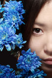 Asian beauty. Portrait of asian woman with blue flowers, close-up of half face Stock Photo