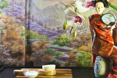 Asian beauty. Composition with orchid, autumn scenery, facial brush, white mask and kimono doll Stock Photography
