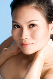 Asian beauty. A beautiful asian woman's face with an engaging gaze Royalty Free Stock Photo