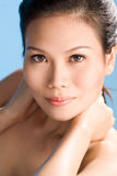 Asian beauty. A beautiful asian woman's face with an engaging gaze Royalty Free Stock Photos