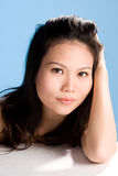 Asian beauty. A beautiful asian woman's face with an engaging gaze Royalty Free Stock Image