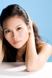 Asian beauty. A beautiful asian woman's face with an engaging gaze Stock Photo