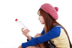 Asian beauty. A beautiful Asian girl holds the water bottle on white background Royalty Free Stock Photography