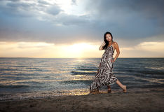 Asian beauty on the beach. Asian beauty girl stay on the beach Stock Images