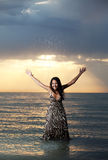 Asian beauty on the beach. Asian beauty girl stay on the beach in water Royalty Free Stock Image