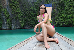 Asian Beauty in Bikini. Seated on the longtail boat Stock Photo