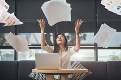 Asian beauty businesswoman throwing paperwork into the air. Successful and achievement concept. Business and Occupation concept. Freelance and business owner stock image