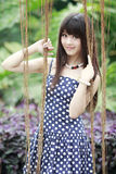 Asian beauty in the garden. Charming Asian beauty smiling in the garden Stock Photo