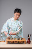 Asian beauty getting ready for tea ceremony Royalty Free Stock Photos