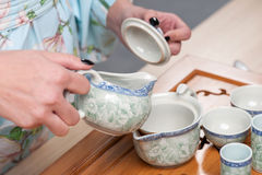 Asian beauty getting ready for tea ceremony Royalty Free Stock Photography