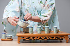 Asian beauty getting ready for tea ceremony Stock Photo