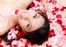 Asian beauty Girl smiling close-up with rose Stock Image