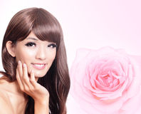Asian beauty hand touch face with pink rose Royalty Free Stock Photos