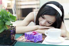 Asian beauty and her gift Royalty Free Stock Photo