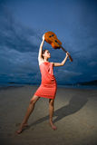 Asian beauty holding a guitar at the beach. Fashion asian model holding a guitar up high at the beach Stock Images