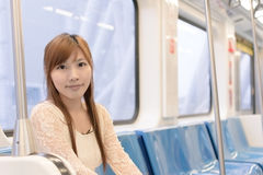 Asian beauty in MRT carriages Stock Images