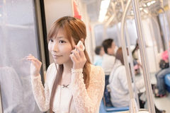 Asian beauty in MRT carriages Royalty Free Stock Photos