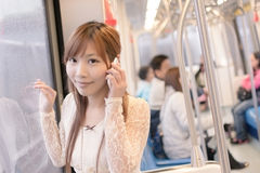 Asian beauty in MRT carriages Royalty Free Stock Images