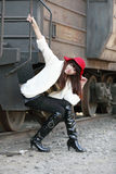 Asian beauty next to train. Asian fashion girl posing next to old train caboose Royalty Free Stock Photo